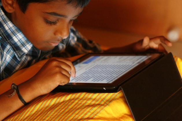Indian boy with iPad
